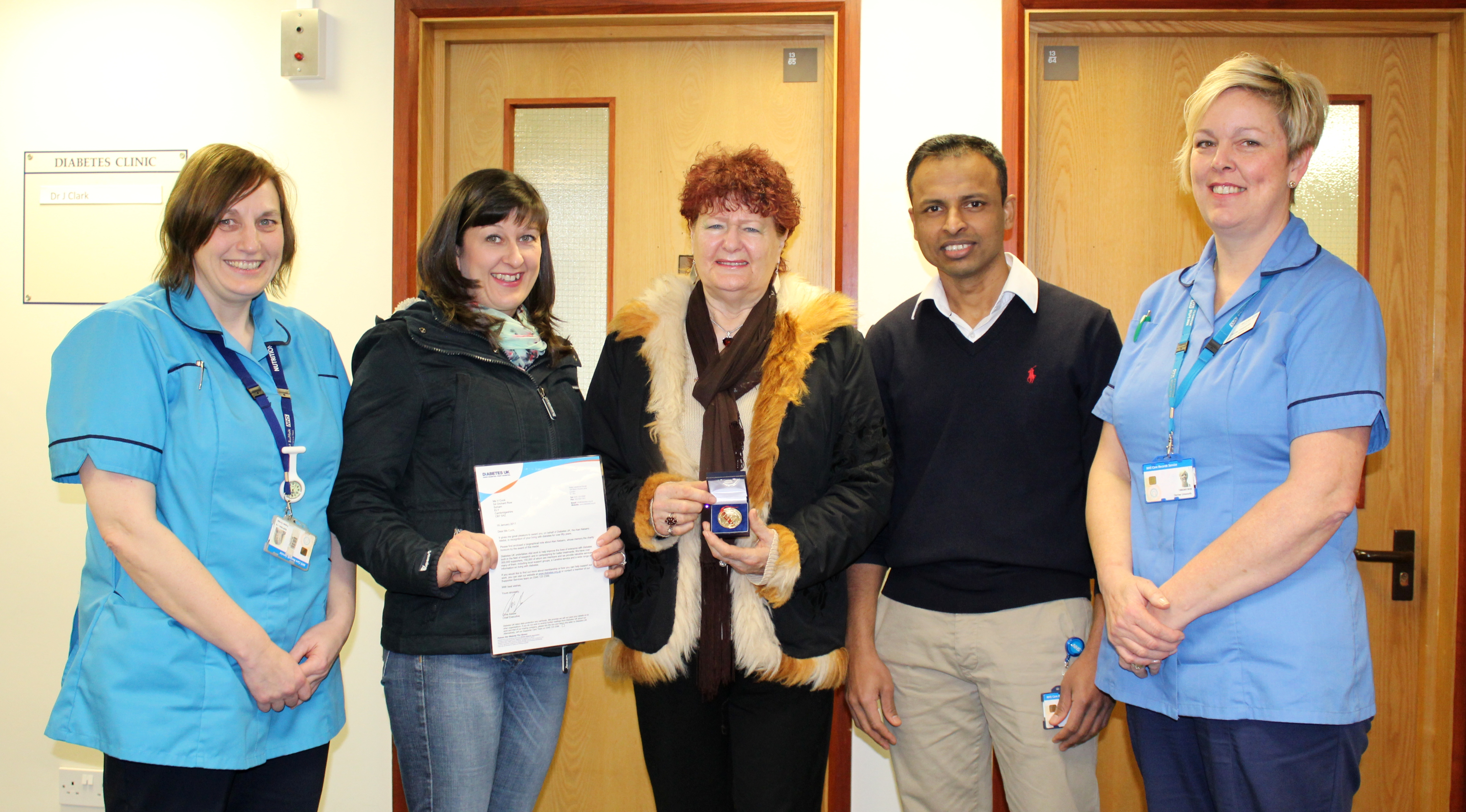Valeria Cook, centre, with her daughter and staff from the diabetes unit.