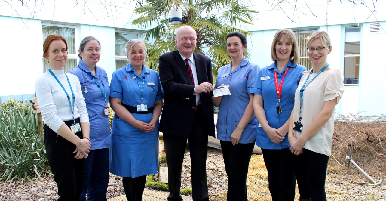 David Kelly, co-founder of A Way With Pain, presents Dawn Pretty, lead clinical nurse specialist in the department of pain medicine, with the donation