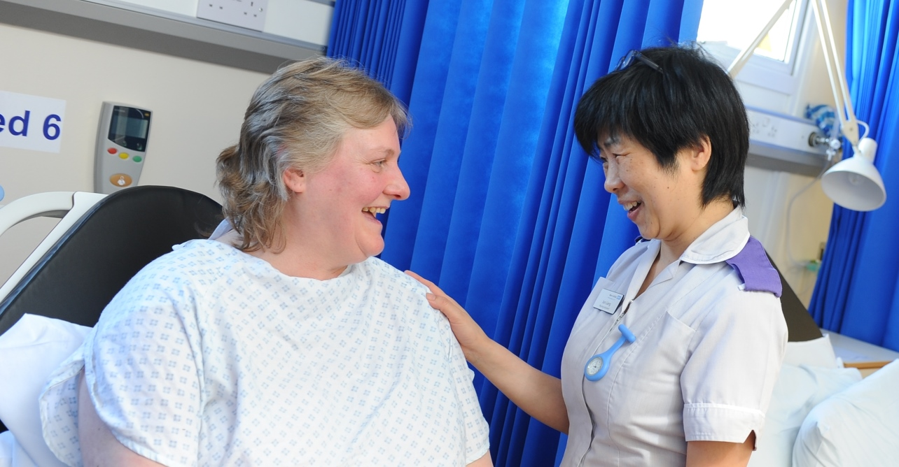 A Trust member of staff with a patient