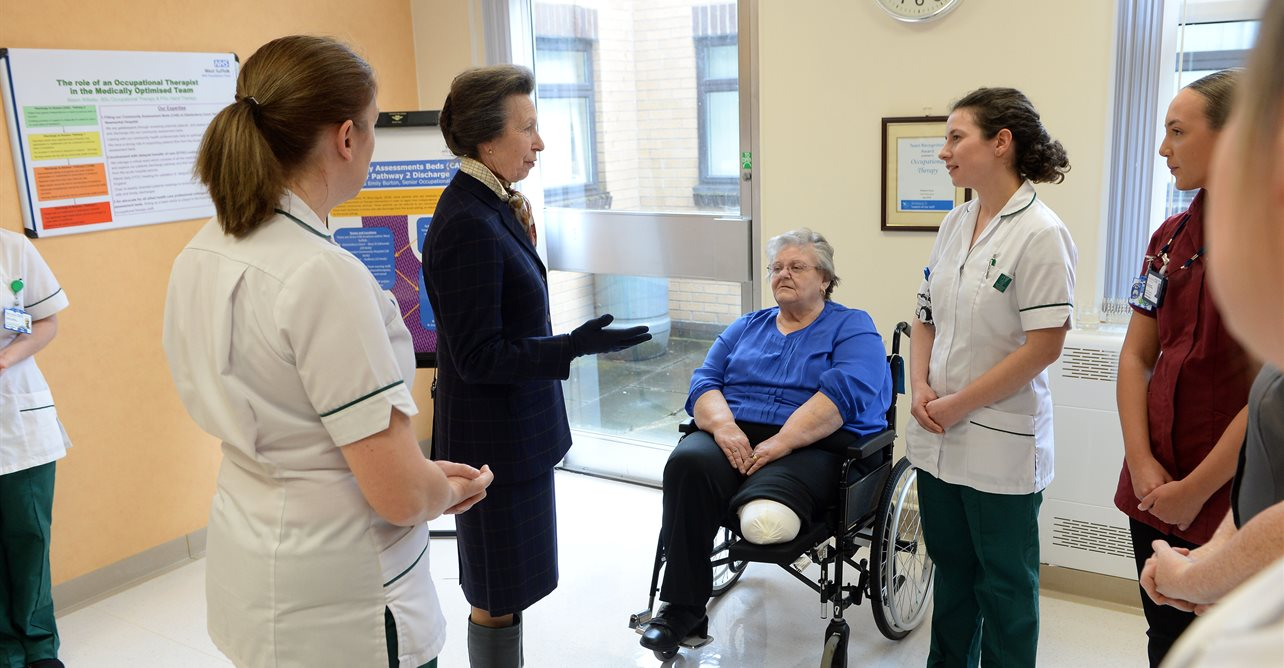 HRH The Princess Royal, speaks to occupational therapists and patient during her visit.