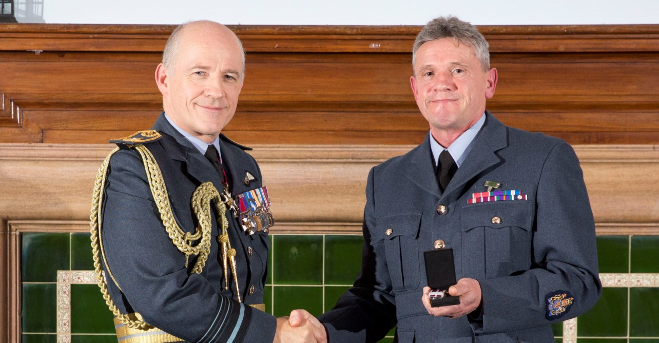 RAF presenting Robert Ley MBE with his meritorious service medal