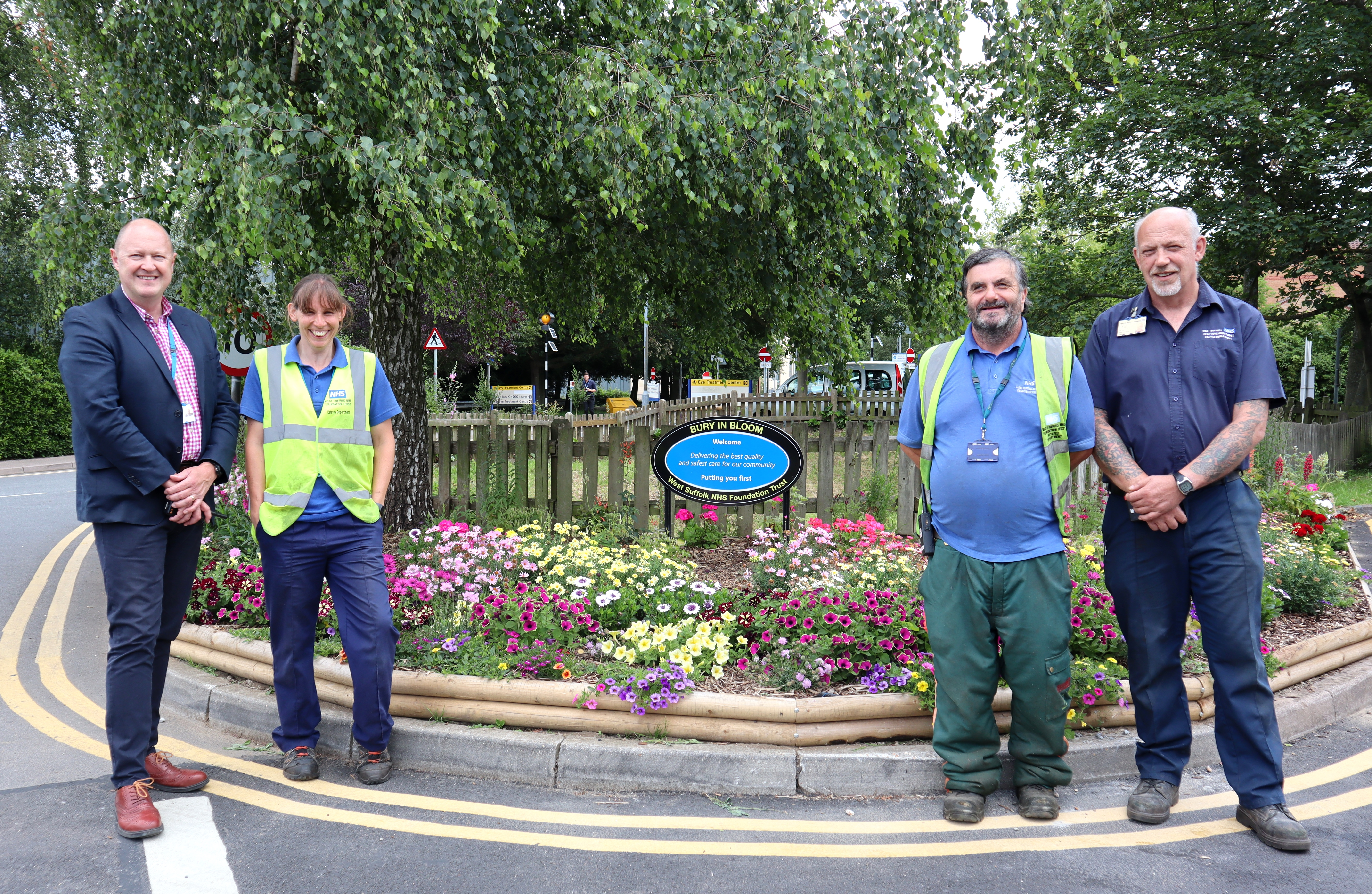 L-R Gary Stannard, estates operations maintenance manager, Sarah Dance, gardener, David Cracknell, gardener, and Ian Purt, builder - the WSFT team behind the blooms