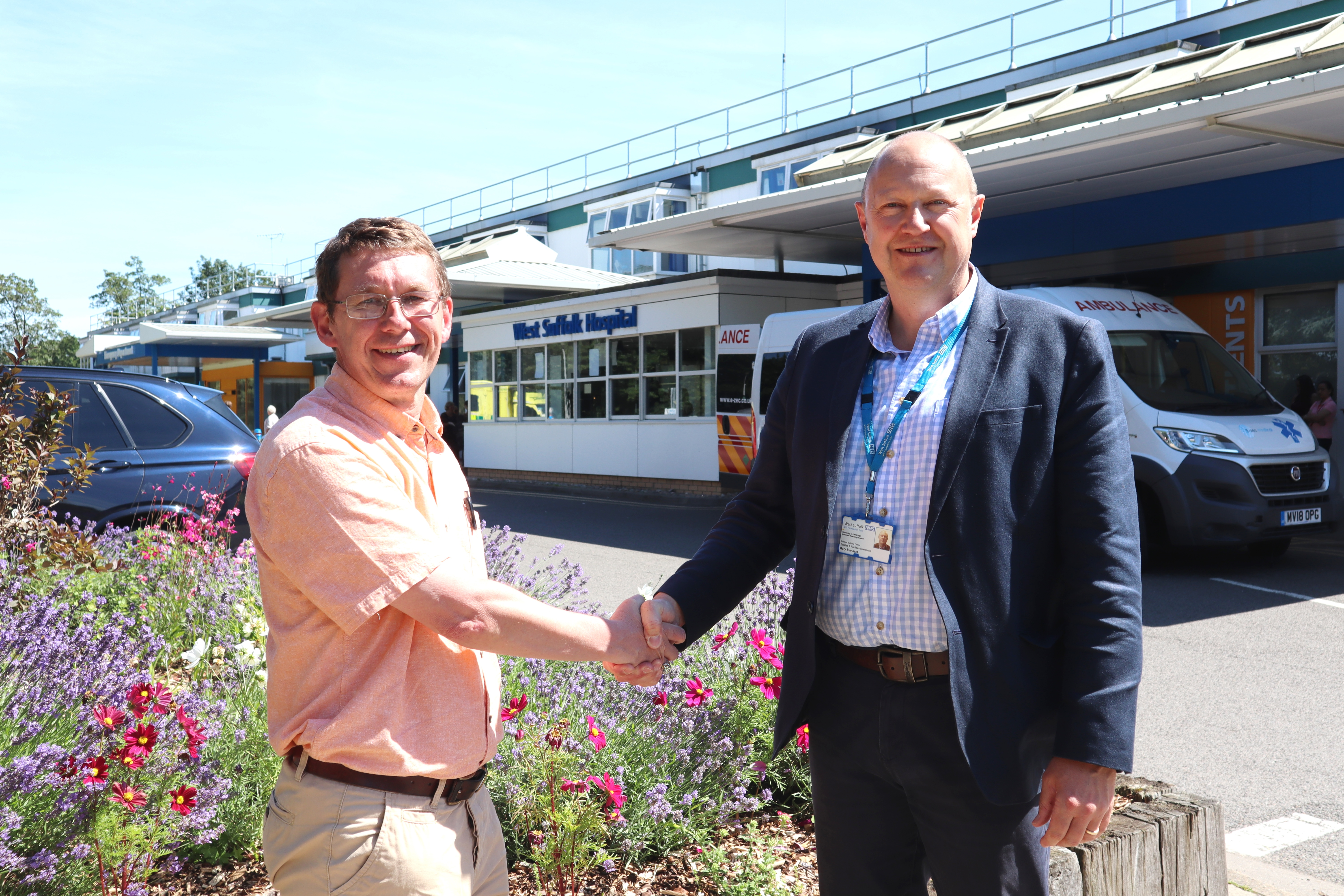 Stephen Bloom, Bury in Bloom co-ordinator, and Gary Stannard, estates operations maintenance manager outside the West Suffolk Hospital