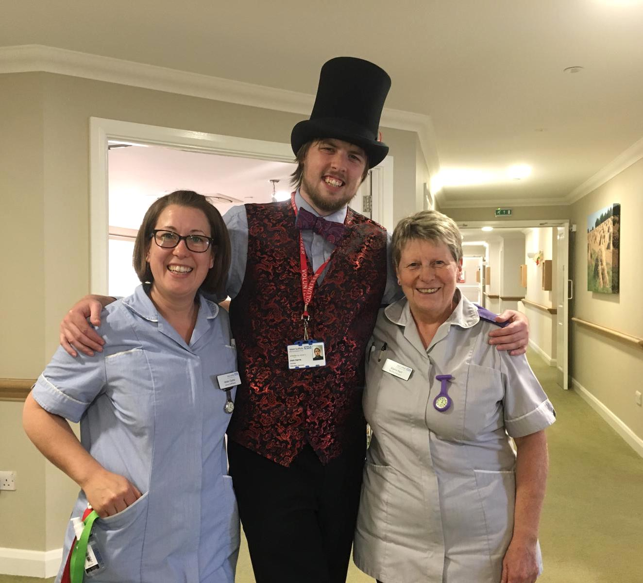Left to right: Helen Clarke, senior staff nurse, storyteller volunteer Joshua Harris, and Glynis Hart, nursing assistant at the WSFT King Suite wing of Glastonbury Court care home