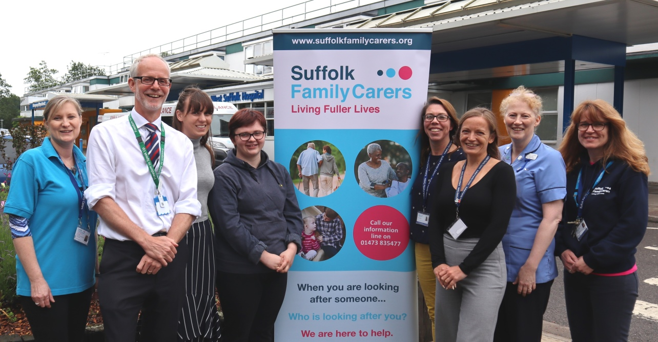 Trust staff and Suffolk Family Carers celebrating the launch of the young adult carer's ID card