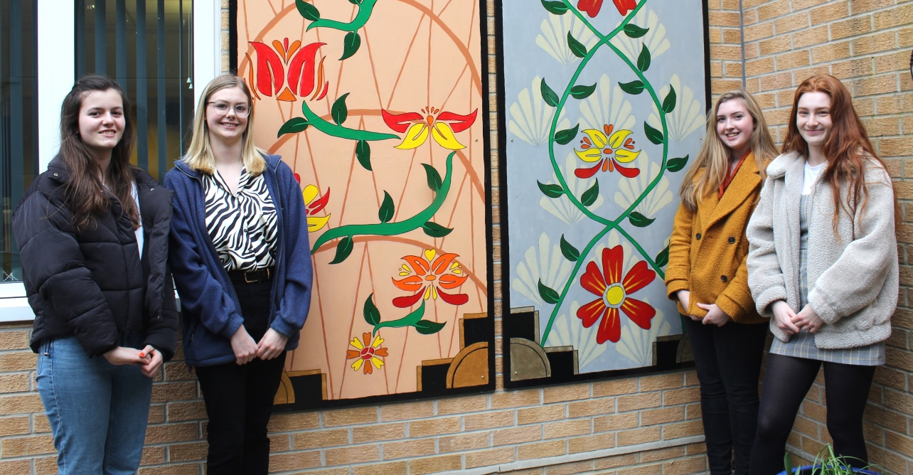 (Left to right) Meredith Halls, 17, Ruth Burgess, 17, Lottie Ellis, 17, Gabrielle Murphy, 18, students from King Edward VI School, Bury St Edmunds, in front of the mural they have created for West Suffolk NHS Foundation Trust.