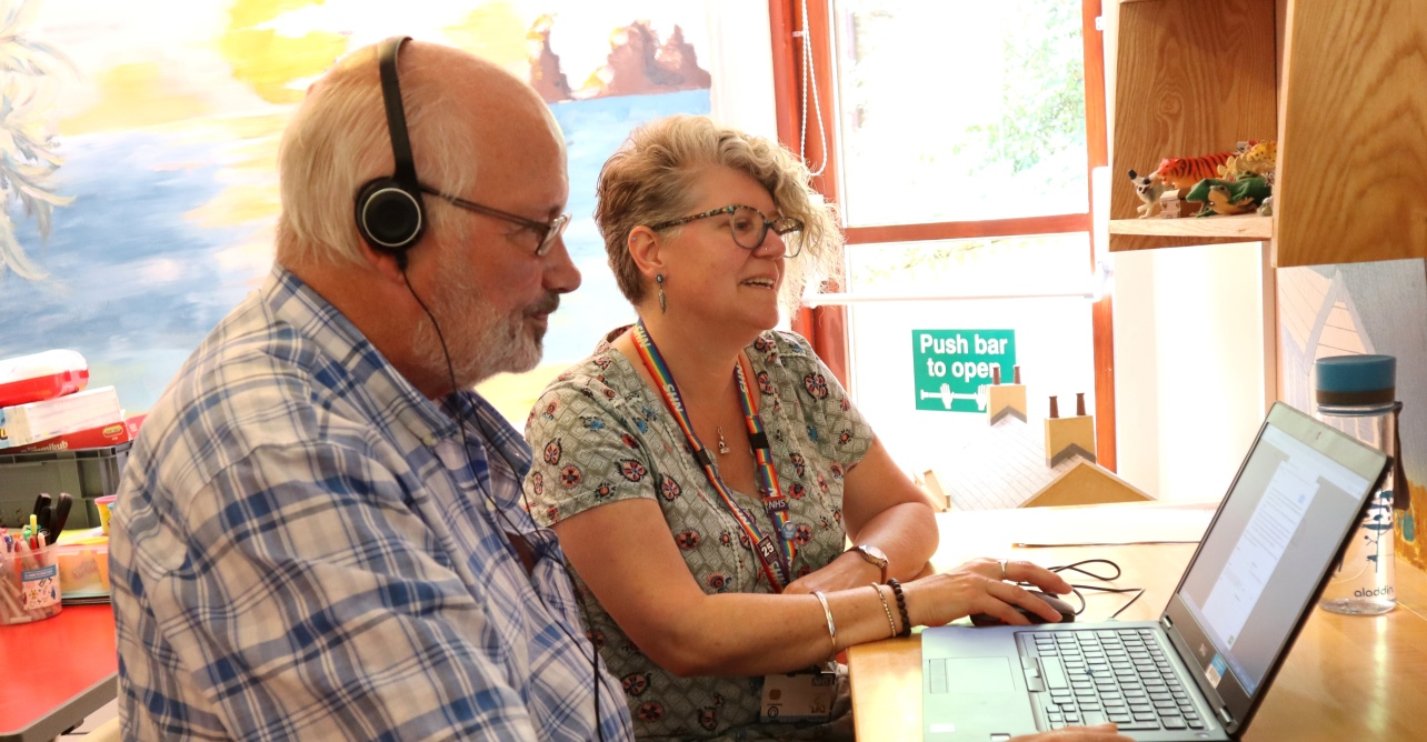 David (left) and Laura Wilkes working together to record David's voice and phrases ready to share with friends and loved ones in the future.