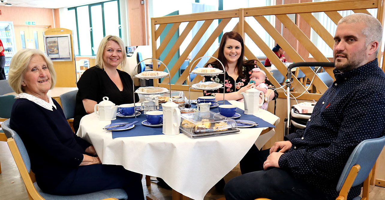 Baby Daisy enjoys afternoon tea at West Suffolk Hospital with her family
