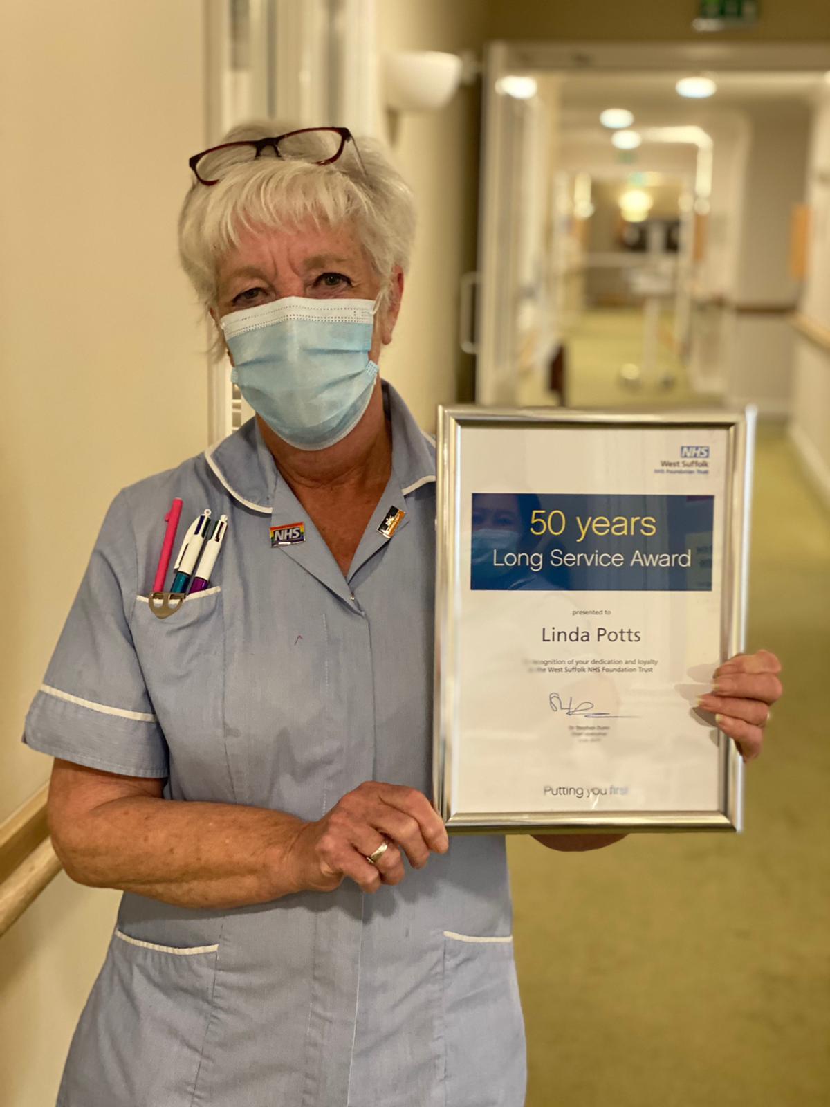 Linda Potts receiving long service award